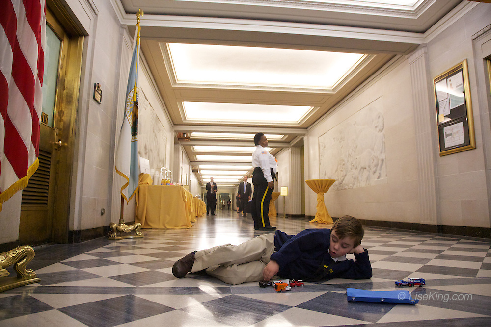 Bernie Register Bercik, son of Army Reserve Colonel Bernard Bercik (Seminole), escort for the Navajo Code Talkers, spent the lunch break playing with his cars and trucks on the marble floors of the DOI hallway.