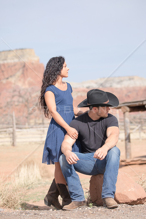 cowboy and a girl outdoors looking off