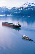 Alaska, Valdez. S/S Denali oil tanker with escort vessels heading for a loading at the Valdez Marine Terminal.