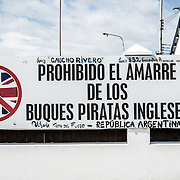 "An anti-British sign in Ushuaia Harbor warning against British ""pirates."" The sentiment goes back to the 1982 conflict between Britain and Argentina over islands off Argentina's coast known in Britain as the Falkland Islands and in Argentina as the Malvinas Islands."