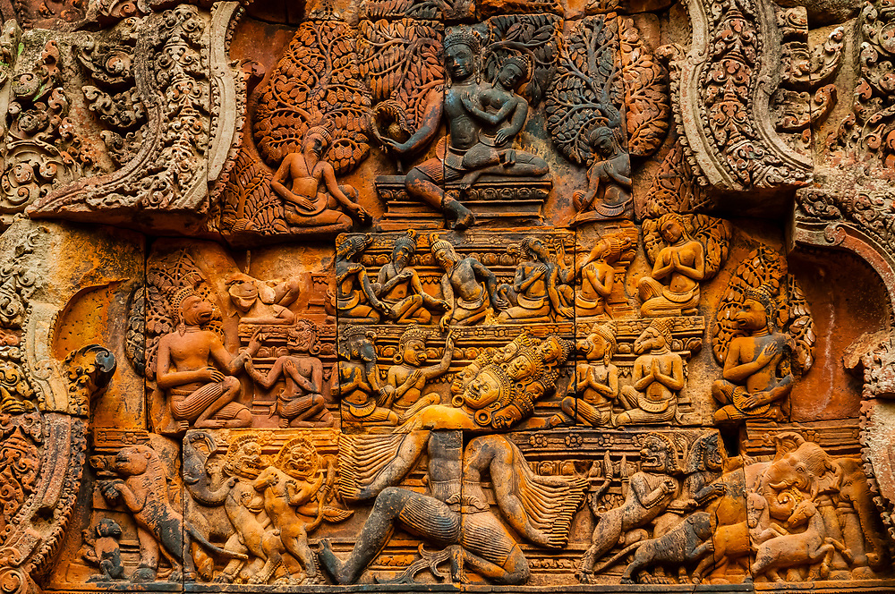 "Banteay Srei or Banteay Srey (""Citadel of the Women"") is a 10th-century Cambodian temple dedicated to the Hindu god Shiva. Banteay Srei is built largely of red sandstone, a medium that lends itself to the elaborate decorative wall carvings which are still observable today. The buildings themselves are miniature in scale, unusually so when measured by the standards of Angkorian construction. Angkor Wat complex, Cambodia."