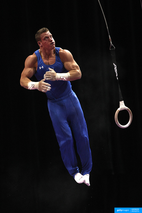 Steven Legendre, Norman, Oklahoma, in action on the Still Rings during the Senior Men Competition at The 2013 P&G Gymnastics Championships, USA Gymnastics' National Championships at the XL, Centre, Hartford, Connecticut, USA. 16th August 2013. Photo Tim Clayton