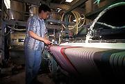Tunisian immigrant employed in rubberizing mats, Nonantola 1996...1996 Nonantola (Modena), immigrato tunisino addetto alla gommatura delle stuoie nella ditta Rossi.