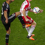 Nov 8, 2015; Harrison, NJ, USA; D.C. United midfielder/forward Chris Pontius (13) tries to kick the ball while being defended by New York Red Bulls midfielder Dax McCarty (11) during the second half of the MLS Playoffs at Red Bull Arena. Mandatory Credit: William Hauser-USA TODAY Sports