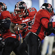 William Penn RB Reginald Carroll (25) breaks though the line for a 25-yard burst up the middle with 18 seconds left in the third quarter of the DIAA State Championship football game between William Penn and Middletown Saturday, Nov. 29 2014, at Delaware Stadium in Newark Delaware.