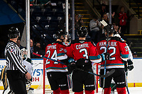 KELOWNA, BC - SEPTEMBER 28:  Sean Comrie #3 celebrates his first regular season goal against the Everett Silvertips with Kyle Topping #24 and Dillon Hamaliuk #22 of the Kelowna Rockets at Prospera Place on September 28, 2019 in Kelowna, Canada. (Photo by Marissa Baecker/Shoot the Breeze)
