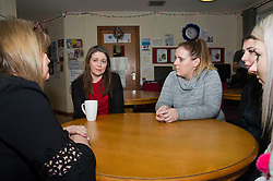 Pictured: Aileen Campbell met workers and volunteers Danielle Leadbetter (black dress), Rachel Gardener (grey top), Darcy Hughes (Tartan dress) and Heather Thorborn (white juimper)<br /> <br /> Communities Secretary Aileen Campbell visited the Muirhouse Millennium Centre in Edinburgh today and met with support workers of the Low Income Families Together project as the latest update on tackling poverty was published.<br /> <br /> Ger Harley| EEm 20 December 2018