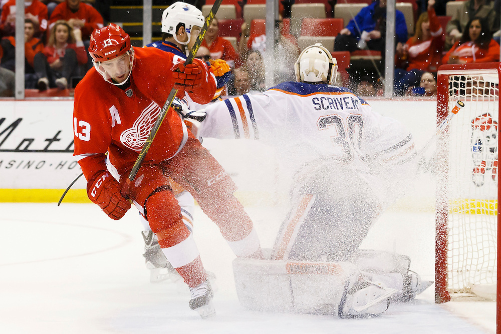 Mar 9, 2015; Detroit, MI, USA; Detroit Red Wings center Pavel Datsyuk (13) sprays Edmonton Oilers goalie Ben Scrivens (30) with snow in the third period at Joe Louis Arena. Detroit won 5-2. Mandatory Credit: Rick Osentoski-USA TODAY Sports