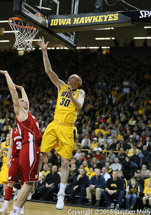 January 19 2013: Iowa Hawkeyes forward Aaron White (30) puts up a shot over Wisconsin Badgers forward/center Jared Berggren (40) during the first half of the NCAA basketball game between the Wisconsin Badgers and the Iowa Hawkeyes at Carver-Hawkeye Arena in Iowa City, Iowa on Sautrday January 19 2013. Iowa defeated Wisconsin 70-66.