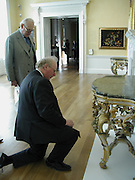 James Miller ( on floor) and hon Peter Egerton-Warburton, Official opening Compton Verney, 23 March 2004. ONE TIME USE ONLY - DO NOT ARCHIVE  © Copyright Photograph by Dafydd Jones 66 Stockwell Park Rd. London SW9 0DA Tel 020 7733 0108 www.dafjones.com