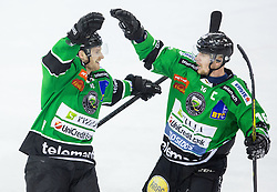 25.01.2015, Hala Tivoli, Ljubljana, SLO, EBEL, HDD Telemach Olimpija Ljubljana vs EHC Liwest Linz, 43. Runde, in picture Tom Zanoski (HDD Telemach Olimpija, #10) and Ales Music (HDD Telemach Olimpija, #16) celebrate during the Erste Bank Icehockey League 43. Round between HDD Telemach Olimpija Ljubljana and EHC Liwest Linz at the Hala Tivoli, Ljubljana, Slovenia on 2015/01/25. Photo by Vid Ponikvar / Sportida