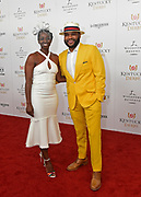 Actor Anthony Anderson and his wife Alvina Stewart walk the Kentucky Derby red carpet, Saturday, May 5, 2018, at Churchill Downs in Louisville, Ky.  Longines, the Swiss watch manufacturer known for its luxury timepieces, is the Official Watch and Timekeeper of the 144th annual Kentucky Derby. (Photo by Diane Bondareff/Invision for Longines/AP Images)