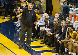 Mar 2, 2016; Morgantown, WV, USA; West Virginia Mountaineers head coach Bob Huggins calls out a play from the bench during the first half against the Texas Tech Red Raiders at the WVU Coliseum. Mandatory Credit: Ben Queen-USA TODAY Sports