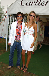 ANDY WONG and LADY VICTORIA HERVEY at the 2005 Cartier International Polo between England & Australia held at Guards Polo Club, Smith's Lawn, Windsor Great Park, Berkshire on 24th July 2005.<br />