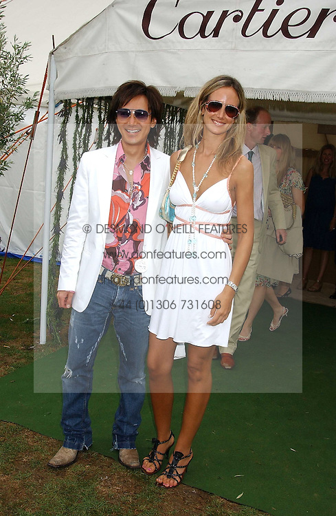 ANDY WONG and LADY VICTORIA HERVEY at the 2005 Cartier International Polo between England & Australia held at Guards Polo Club, Smith's Lawn, Windsor Great Park, Berkshire on 24th July 2005.<br /><br />NON EXCLUSIVE - WORLD RIGHTS