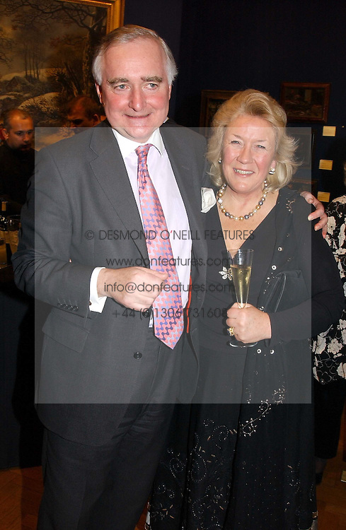 SIR TIMOTHY & LADY CLIFFORD  at a reception hosted by Brian Ivory Chairman of the Trustees of The National Galleries of Scotland to commemorate Sir Timothy Clifford's 21 years of Director of the National Gallery of Scotland and his forthcoming retirement in January 2006, held at Christie's, King Street, London W1 on 6th December 2005.<br /><br />NON EXCLUSIVE - WORLD RIGHTS