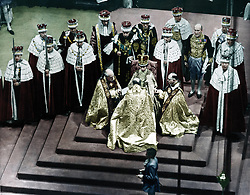 May 25, 2017 - Westminster Cathedral, London, UK: A colourised image of Queen Elizabeth II during the coronation, surrounded by her bishops. STUNNING COLOURISED PHOTOS from a new photobook Retrographic show the day the Queen was coronated with husband Philip by her side have emerged this week, on the Royal couple's platinum wedding anniversary. Photos from the couple's 70 years as husband and wife show the two at a string of state visits from around the world, with one image showing the two posing for a picture with former U.S. President John F Kennedy and first lady Jackie. / Public Domain / mediadrumworld.com (Credit Image: © Public Domain/mediadrumworld.com via ZUMA Press)