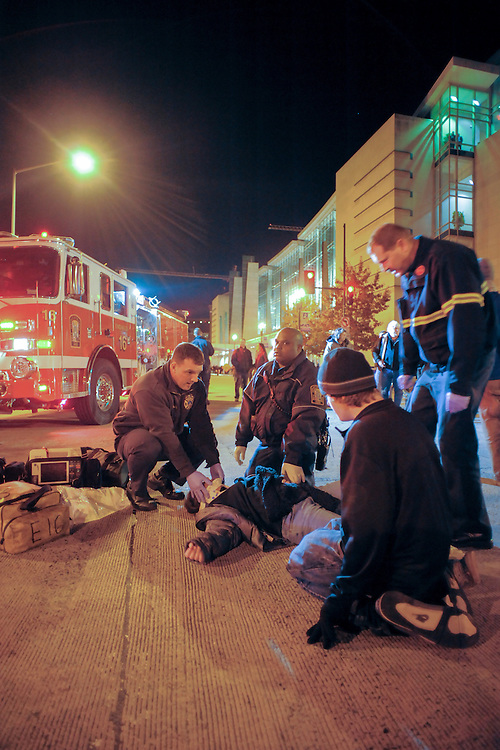 "An unidentified protester is tended to by paramedics after being hit by a vehicle that drove through a line of protesters attempting to block the street. The protesters were demonstrating against the ""Defending the American Dream"" summit at the Washington D.C. Convention Center. An event sponsored by the Americans for Prosperity Foundation. November 04, 2011 in Northwest Washington."