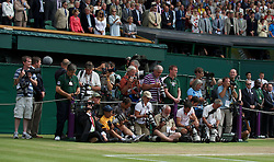 LONDON, ENGLAND - Sunday, July 4th, 2010: Photographers await the presentation during the Gentlemen's Singles Final match on day thirteen of the Wimbledon Lawn Tennis Championships at the All England Lawn Tennis and Croquet Club. (Pic by David Rawcliffe/Propaganda)