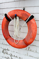 An orange life ring hangs on a wall at the Head Harbor Lighthouse on Campobello Island.