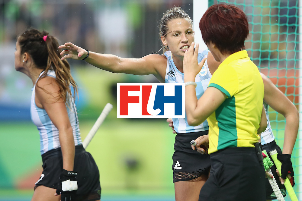 RIO DE JANEIRO, BRAZIL - AUGUST 10:  Delfina Merino of Argentina makes her point to the referee during the women's pool B match between Great Britain and Argentina on Day 5 of the Rio 2016 Olympic Games at the Olympic Hockey Centre on August 10, 2016 in Rio de Janeiro, Brazil.  (Photo by Mark Kolbe/Getty Images)