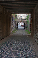 Germany, River Rhine. View down an alleyway and through an arch in an old town in Southern Germany.