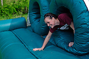 A participant climbs through the inflatable obstacle course during the first part of the O'Bleness Race for a Reason Mud Run, Saturday, April 27, 2013. The course included a four-mile run up to the old Army ROTC Course at the Ridges, through the Radar Hill Trail and back to Tail Great Park across from Peden Stadium. Race for a Reason, Race 4 A Reason, Annual Events, Events, Students, Faculty & Staff