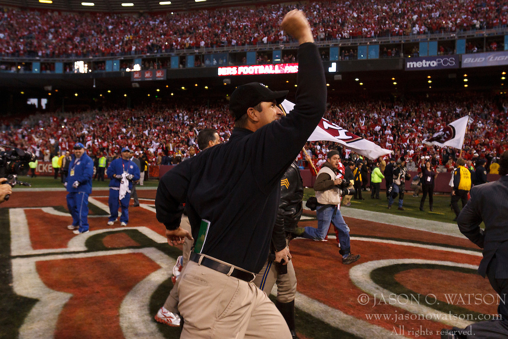 Jan 14, 2012; San Francisco, CA, USA; San Francisco 49ers head coach Jim Harbaugh celebrates after the game against the New Orleans Saints in the 2011 NFC divisional playoff game at Candlestick Park. San Francisco defeated New Orleans 36-32. Mandatory Credit: Jason O. Watson-US PRESSWIRE