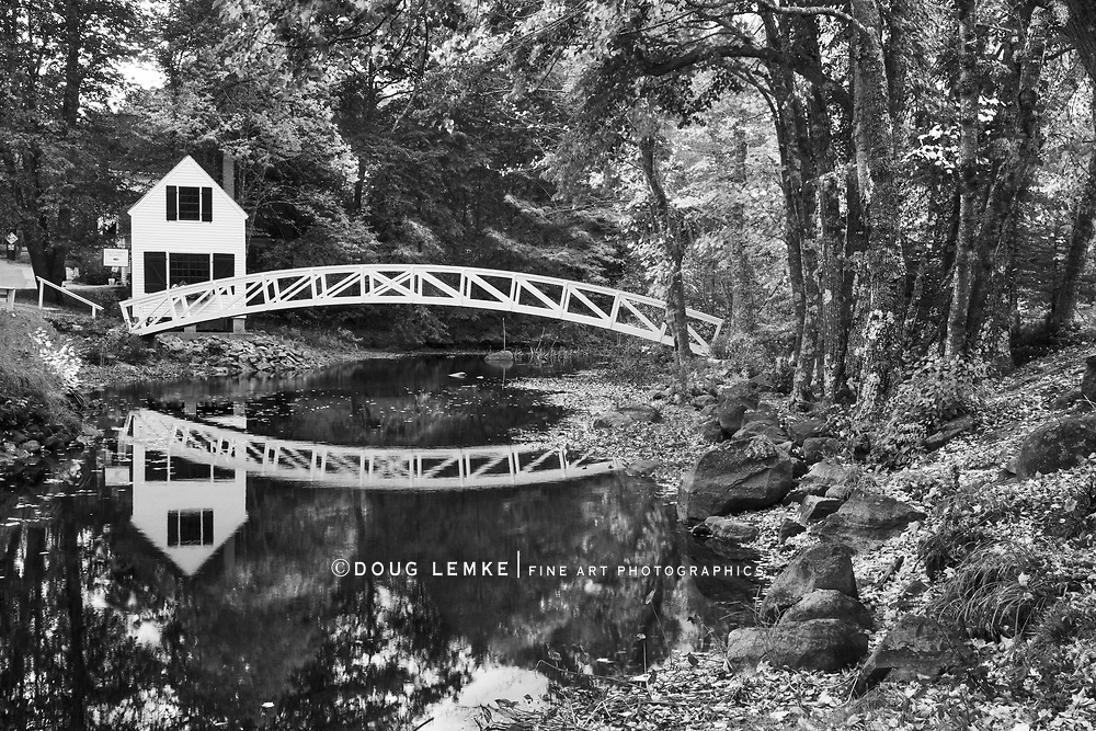 A little white house and arched wooden foot bridge At Acadia National Park, Maine, USA