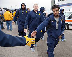 West Virginia running back Rushel Shell walks off the bus as he enters the stadium in Memphis, TN for the Liberty Bowl.