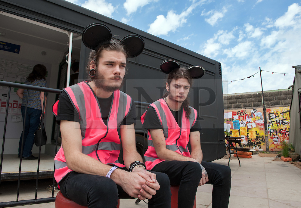 © Licensed to London News Pictures. 22/08/2015. Weston-super-Mare, North Somerset, UK.  Dismaland guides on the first main day of BANKSY's Dismaland show at the old Tropicana on Weston seafront, when the event is open to the general public. Photo credit : Simon Chapman/LNP