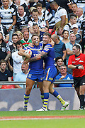 Daryl Clark celebrates with Matty Russell after Warrington open the scoring during the Challenge Cup Final 2016 match between Warrington Wolves and Hull FC at Wembley Stadium, London, England on 27 August 2016. Photo by Craig Galloway.