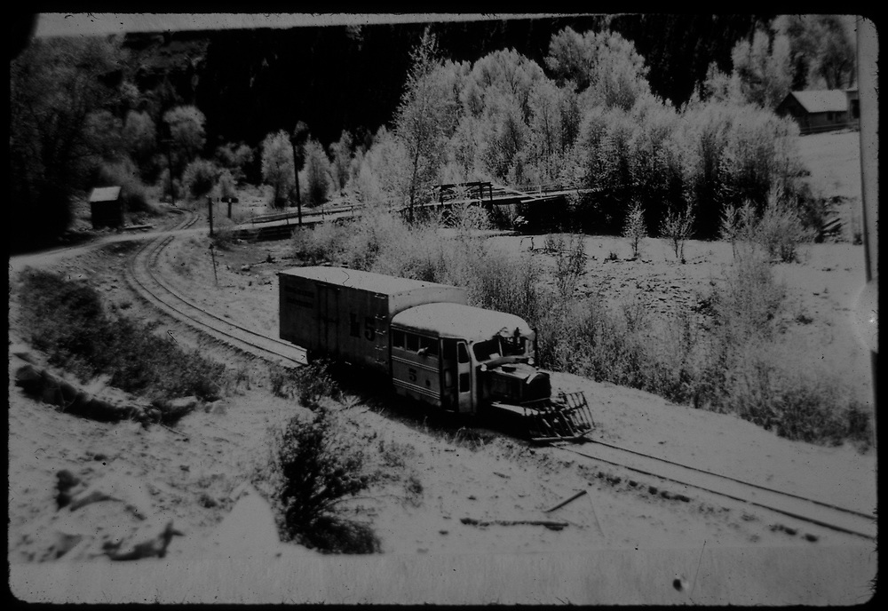 "RGS Goose #5 northbound in snow, passing the Newmire road bridge at Vanadium.<br /> RGS  Vanadium (Newmire), CO  Taken by Maxwell, John W. - 5/26/1949<br /> In book ""RGS Story, The Vol I: Over the Bridges-Ridgway to Telluride"" page 308<br /> Thanks to Don Bergman for additional information."