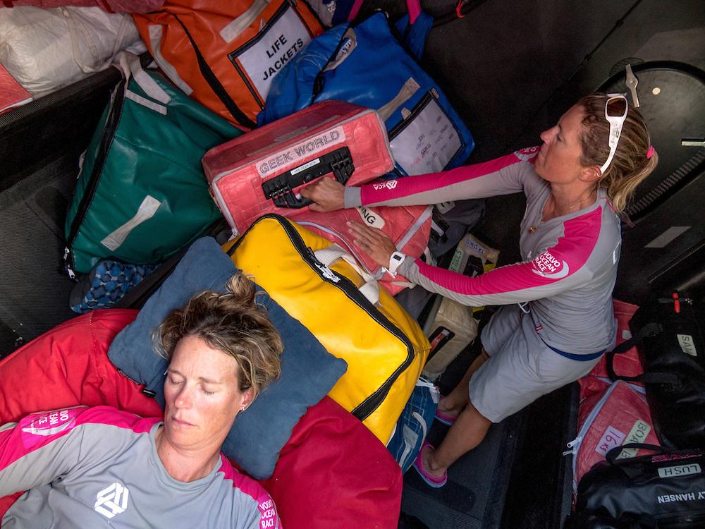December 3, 2014. Leg 2 onboard Team SCA. Sam Davies stacks around a sleeping Carolijn Brouwer.