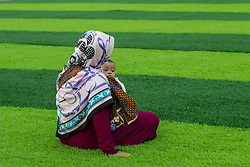 February 14, 2013 - Central Jakarta, Jakarta, Indonesia - Muslim woman during Eid Al-Fitr prayer on plastic grass at futsal stadium on June 15, 2018 in Jakarta, Indonesia. Muslims around the world are celebrating Eid al-Fitr, the three day festival marking the end of the Muslim holy month of Ramadan, it will be observed on 15th or 16th of June depending on the lunar calendar. Eid al-Fitr is one of the two major holidays in Islam. (Credit Image: © Afriadi Hikmal via ZUMA Wire)