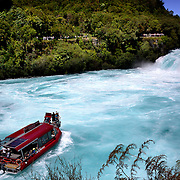 A tourist boat visits The Huka Falls. The Huka Falls are the largest falls on the Waikato River, near Taupo on New Zealand's North Island..They are the most visited natural attraction in New Zealand!.The Waikato river is one of New Zealand's longest rivers and it drains Lake Taupo - the largest freshwater lake in all of Australasia. .At the Huka Falls, the Waikato River which is normally 100m wide, is squeezed through a 20 metre wide gorge and over a 20m drop..Every second up to 220,000 litres of water gushes through the gorge and shoots out over 8 metres beyond to create a beautful blue/green pool...The name Huka is the Maori word for 'foam', which is appropriate as the falling water and rapids certainly resembles foam, especially under flooding conditions.Lake Taupo, New Zealand,, 8th January 2011.  Photo Tim Clayton.