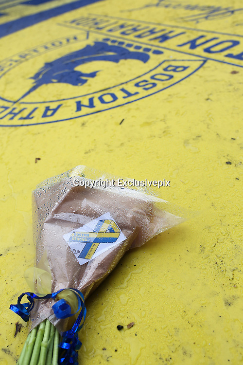 April 14, 2014 - Boston, Massachusetts, USA - <br /> <br /> Boston Marathon Bombing Anniversary<br /> <br /> The Boylston Street finish line was adorned by flowers today on the one-year anniversary of the Boston Marathon bombings.<br /> &copy;Exclusivepix