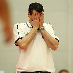 Bristol Flyers head coach, Andreas Kapoulas has his head in his hands - Photo mandatory by-line: Robbie Stephenson/JMP - Mobile: 07966 386802 - 18/04/2015 - SPORT - Basketball - Bristol - SGS Wise Campus - Bristol Flyers v Leeds Force - British Basketball League