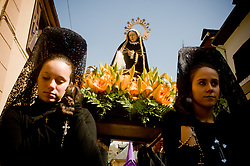 April 14, 2017 - Bossost, Lleida, Spain - In the aranes village of Bossost penitent women wearing mantillas carry an image of Virgin Mary during  the Holy Friday procession. In the village of Bossost, Pyrenees mountains at Vall d'Aran region, neighbours take to the streets every year to hold the holy friday procession. Bossost is the unic  village that still holds this tradition in the Vall d'Aran region and has its origins from 1879. (Credit Image: © Jordi Boixareu via ZUMA Wire)