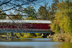 2015 Oct 19:   Parke County Indiana is the site of the Indiana Covered Bridge Festival every October.  This is the Bridgeton.  It was built over Big Raccoon Creek in Bridgeton in 2006 to replace an original bridge which was destroyed by arson in 2005.  It was completely rebuilt private funds. The bridge has a 245' span.<br /> <br /> This image was produced in part utilizing High Dynamic Range (HDR) processes.  It should not be used editorially without being listed as an illustration or with a disclaimer.  It may or may not be an accurate representation of the scene as originally photographed and the finished image is the creation of the photographer.