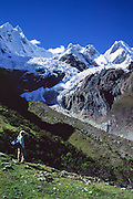 "Yerupaja Grande is the highest point in the Amazon River watershed (far right, west face, 6635 m or 21,768 ft), the second-highest peak in Peru, and highest in Cordillera Huayhuash. In the center is Mount Jirishanca, or the ""Icy Beak of the Hummingbird"" (6126 m or 20,098 feet elevation), in the Andes Mountains, Peru, South America."