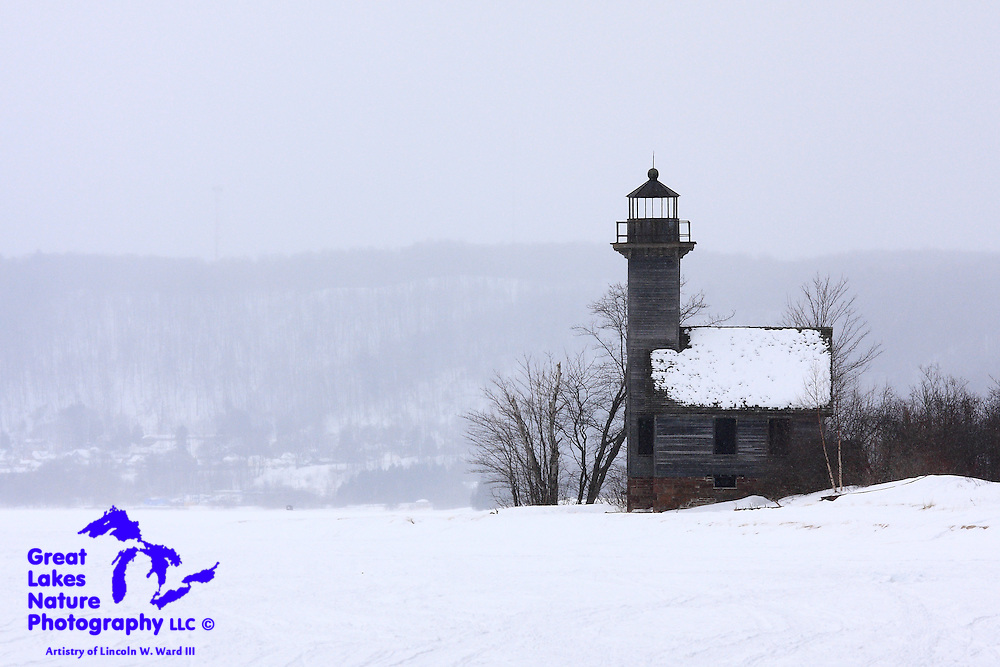 Perhaps the most photographed lighthouse in all of Michigan, the Grand Island East Channel Light is a study in simplicity. It hasn't been used as aid to navigation since the early 1900's, but it is a symbol of the state, of the Upper Peninsula, of Munising, and a regular itinerary item on the various boat trips to the Pictured Rocks National Lakeshore in summer. I captured this image of the lighthouse from the ice during a brief snow squall, resulting in the ghostly appearance of Munising in the background.