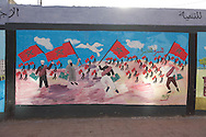 Morocco , Casablanca ,  people walking in front of mural paintings,