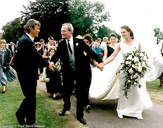 Wensley Haydon-Baillie former owner of Wentworth Woodhouse with his new bride Samantha Acland (and cousin) is congratulated by a well wisher on the walk back to Wentworth Woodhouse...Images © Paul David Drabble