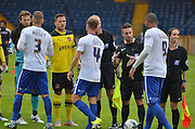 greetings are exchanged during the Sky Bet League 1 match between Bury and Fleetwood Town at Gigg Lane, Bury, England on 18 August 2015. Photo by Mark Pollitt.