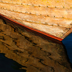 The bow of a wooden skiff in Rye Harbor, New Hampshire.
