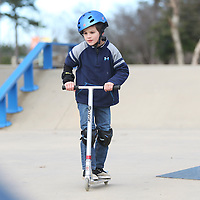Lauren Wood | Buy at photos.djournal.com<br /> Nathan Williams, 8, of Corinth, nears a ramp on his scooter while riding Monday afternoon at the skatepark at Ballard Park. Nathan was at the park with his father Frank and they were testing differences between riding a scooter and riding a skateboard for a science project of Nathan's.