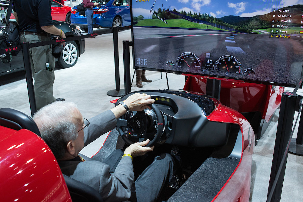 New York, NY - 1 April 2015. A visitor to the New York International Auto Show tries driving the Toytoa FT-1 simulator. The FT-1 is a concept car designed for track use.