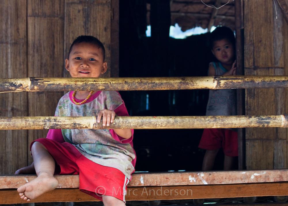 Children in a bamboo house,  Mae Sam Laep, Mae Hong Son Province, Thailand