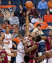Virginia guard Calvin Baker (4) shoots against Elon.  The Virginia Cavaliers men's basketball team defeated the Elon Phoenix 91-61  at the John Paul Jones Arena in Charlottesville, VA on December 22, 2007.